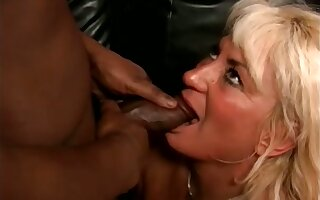 Amateur blonde adult slut stands in excess of knees while sucking strong BBC