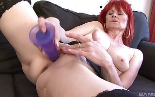 Redhead mature Patricie craves for a detailed black dick in the brush holes