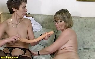 Two powered german mature in sexy stockings sharing a Cyclopean dildo