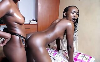 Three hot African girls fuck each time outer with strapon live to hand