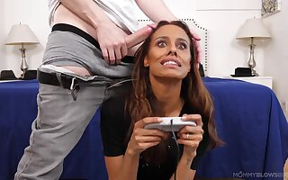 Tanned belle sucks dick while playing her video games