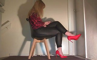 Ignoring you in leather pants and red high heels.