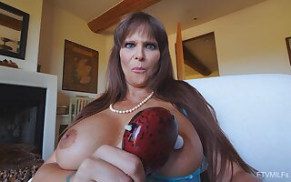 Foxy mature star Syren moans while playing with a vibrator