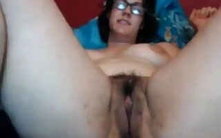 Thick nerdy milf with a charming hairy pussy