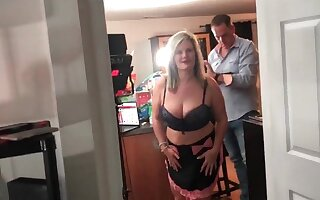 Horny amateur swingers sucking a hard cock during an exclusive swing party