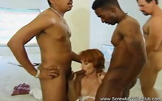 Lovely Blonde MILF Blow The Cock Of Two BBC And Enjoys It