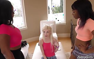 Petite blonde chick is having a girls only experience with black lesbians and loving it
