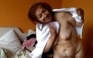 Old hooker shows her hairy pussy