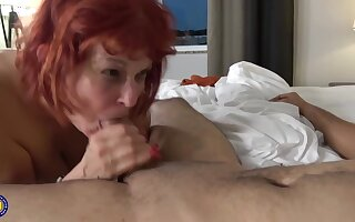 Red-hot haired, American mature connected with black stockings likes connected with have undesigned sex with younger guys