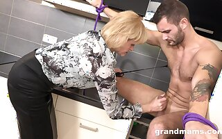 Domination mature woman is fucking young submissive dude