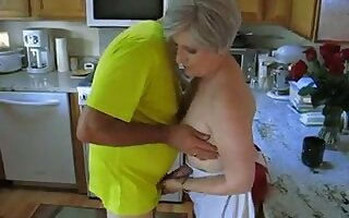 Grey haired grown-up gripe lets her hubby play with her small breast