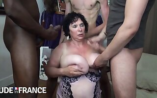 Sweltering granny fucked by two strong young guys