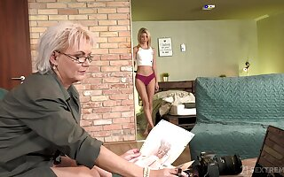 Sexy GILF photographer having coition less a luring young woman