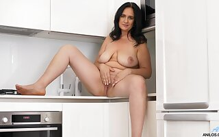 Solo mature brunette Ria Dusky drops her clothes almost the pantry
